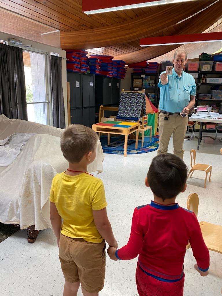 Preschoolers engaged in preschool literacy activities